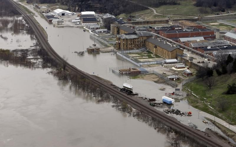 In this aerial photo, floodwater from the Mississippi River threatens the maximum security Menard Correctional Center, Thursday, Dec. 31, 2015, in Chester, Ill. Surging Midwestern rivers forced hundreds of evacuations, threatened dozens of levees and