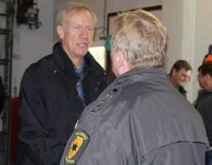 Rauner greets Illinois State Police Director Leo Schmitz at the Villa Grove Fire Station Sunday.