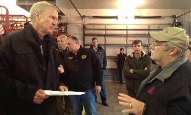 Gov. Bruce Rauner talking with Douglas County EMA Director Joseph Victor