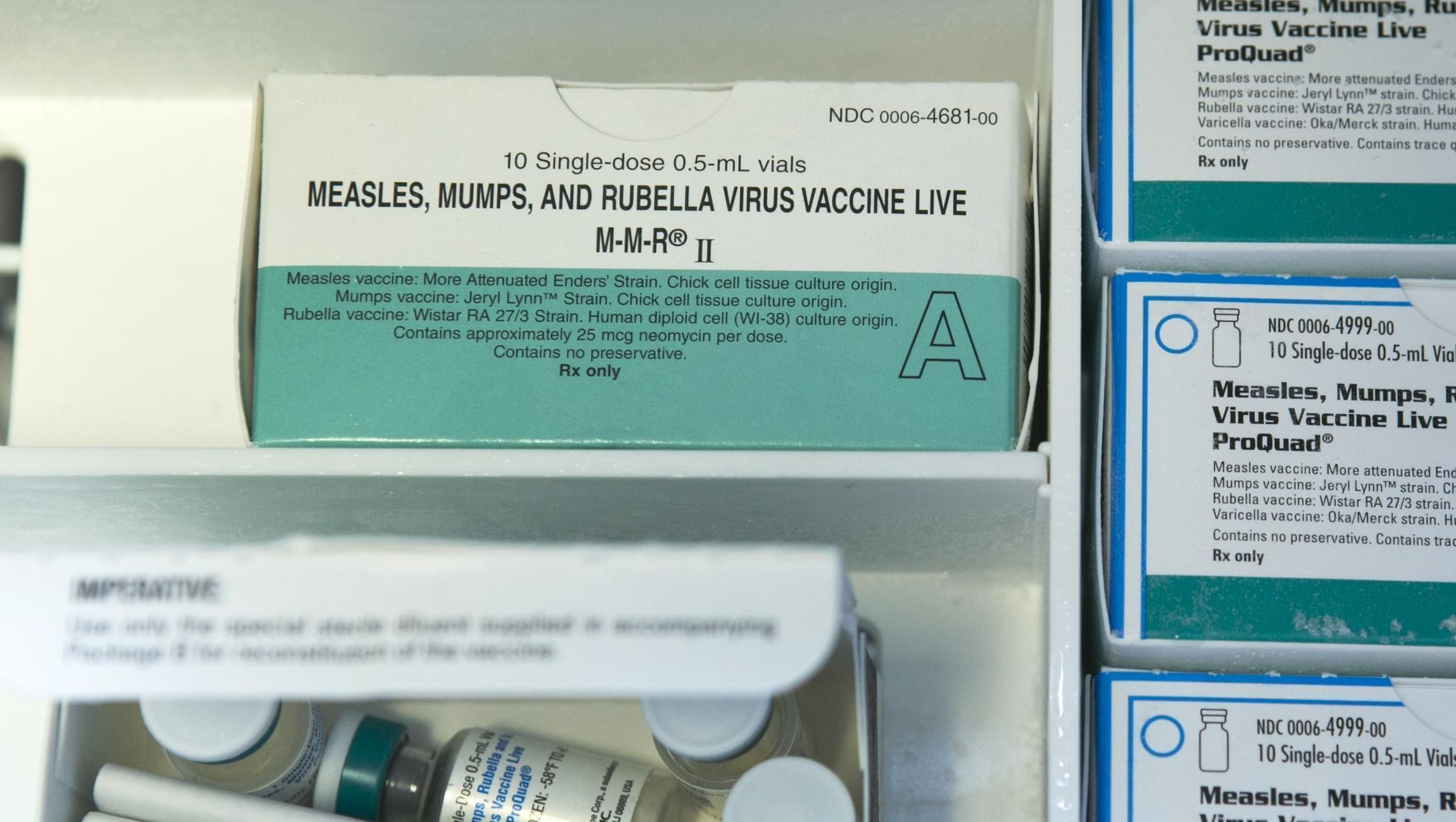 In this Thursday, Jan. 29, 2015, photo, boxes of single-doses vials of the measles-mumps-rubella virus vaccine live, or MMR vaccine and ProQuad vaccine are keep frozen inside a freezer at the practice of Dr. Charles Goodman in Northridge, Calif.