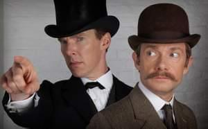 Sherlock and Watson, dressed in Victorian-era clothes.