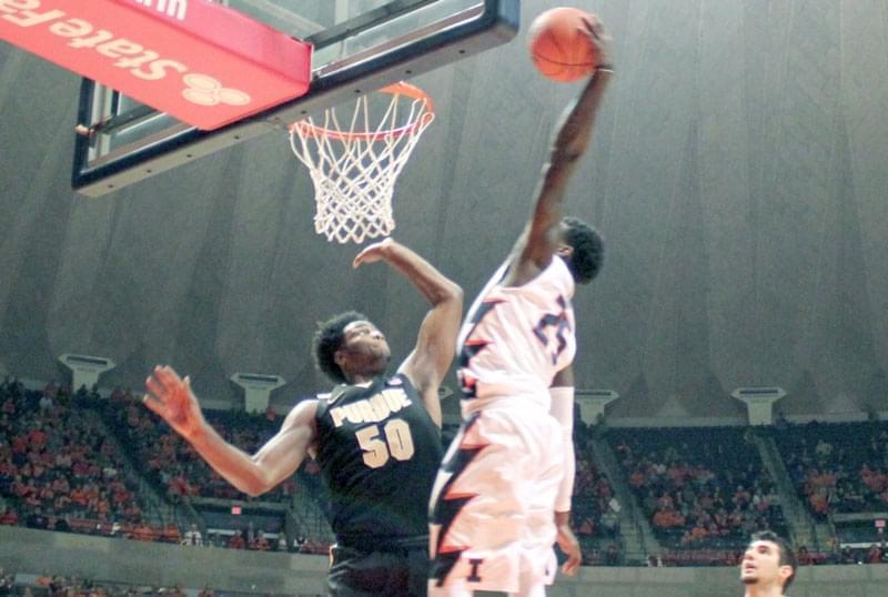 Illini guard Kendrick Nunn dunks overe Purdue's Caleb Swanigan.