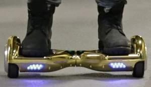 """In this Oct. 5, 2015 file photo, Seattle Seahawks wide receiver B.J. Daniels rides through a hallway at CenturyLink Field on an electric self-balancing scooter commonly called a """"hoverboard."""""""
