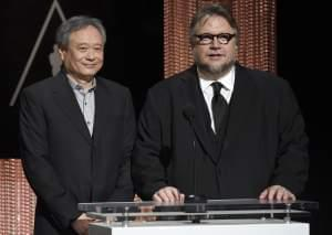 Director and University of Illinois graduate Ang Lee, left, and Guillermo del Toro