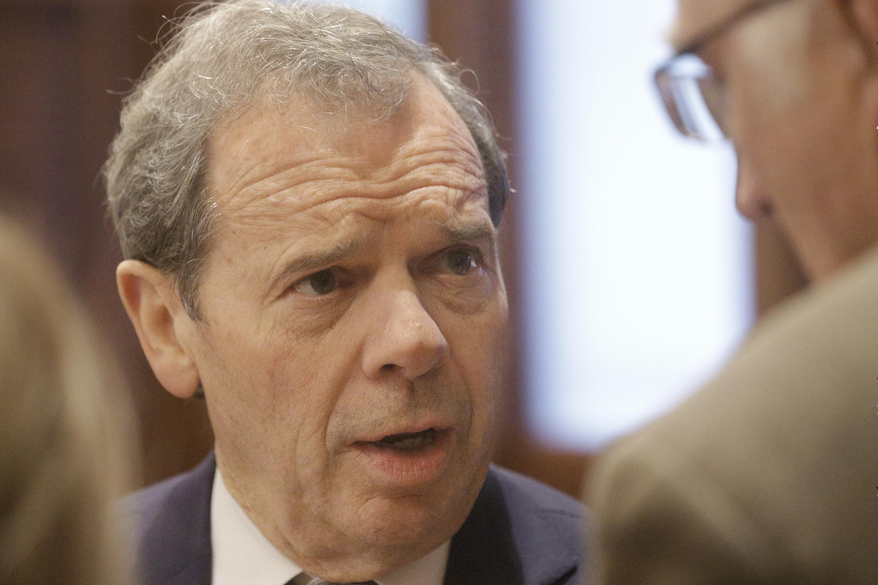 Illinois Senate President John Cullerton, D-Chicago, speaks to reporters while on the Senate floor during session at the Illinois State Capitol Monday, Dec. 7, 2015, in Springfield