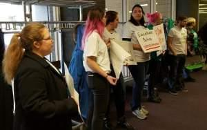 Students demonstrating against layoffs at the Western Illinois University Board of Trustees meeting.