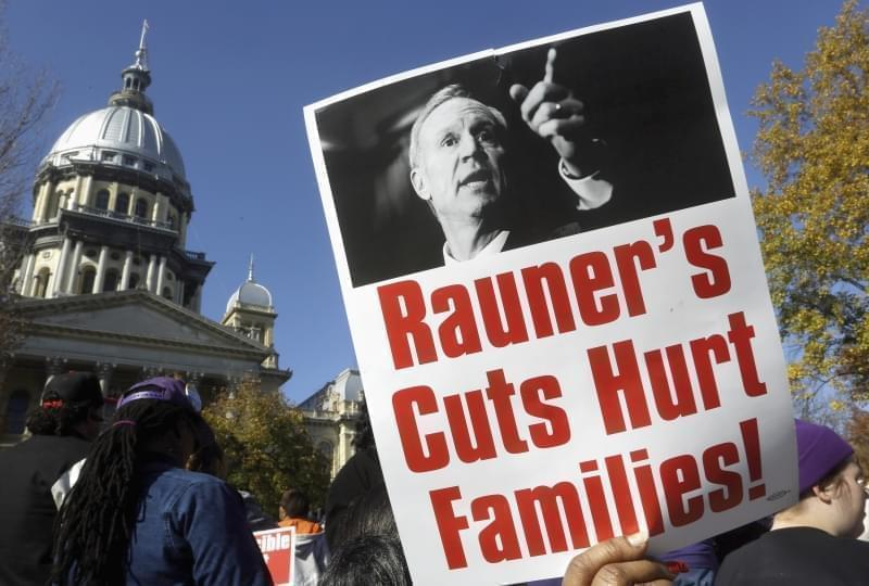 In this Nov. 10, 2015 file photo, protesters rally in support of lawmakers ending the state budget impasse at the Illinois state Capitol in Springfield.