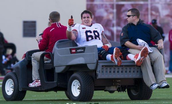 Illinois offensive linesman Simon Cvijanovic is taken from the field after being injured during an NCAA college football game