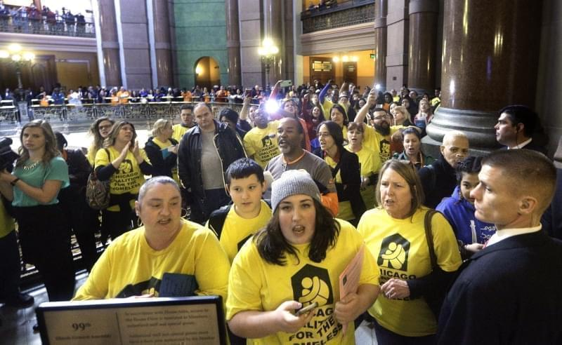 Protestors outside the House chamber while Illinois Gov. Bruce Rauner delivers his State of the State address