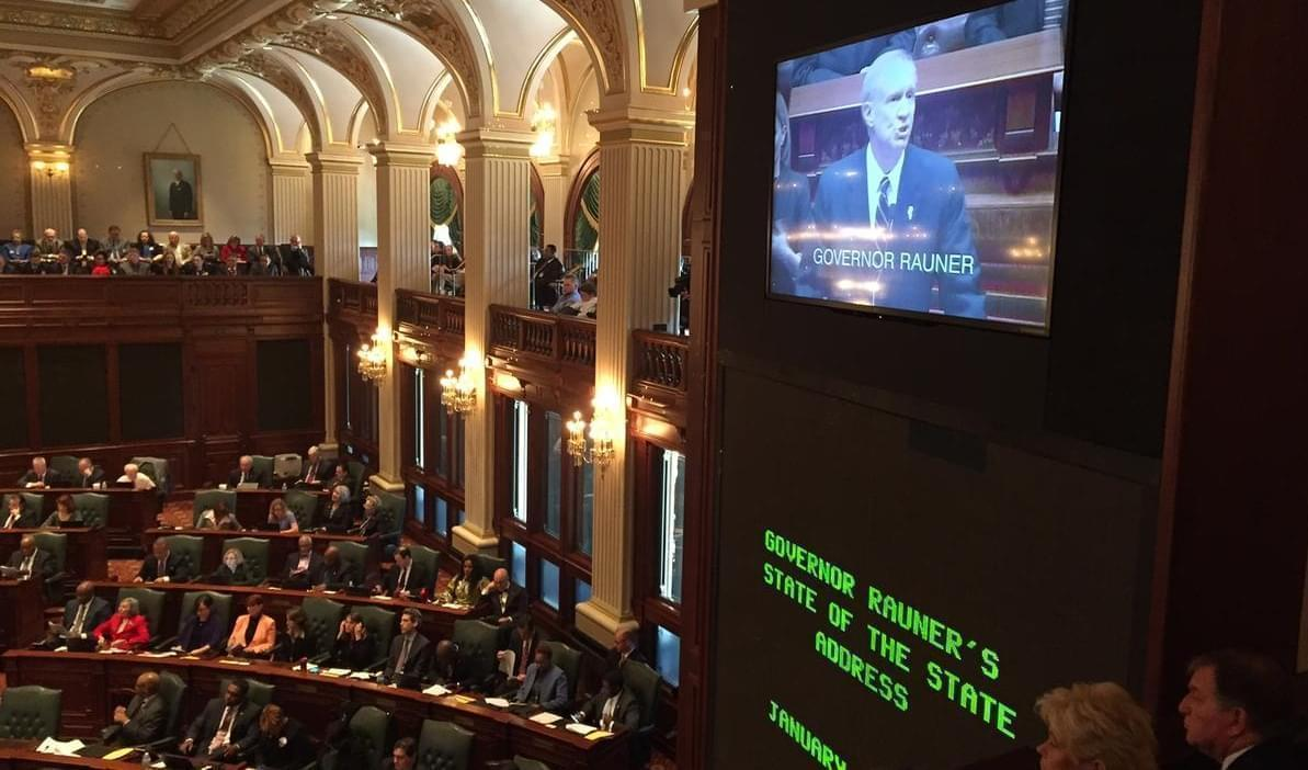 Illinois Gov. Bruce Rauner is seen on a video monitor at the Illinois Statehouse as he delivers his State of the State address