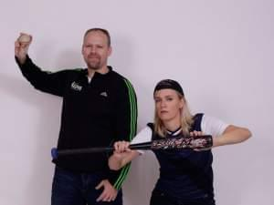 Brian Moline and Lisa Bralts in a baseball pose.