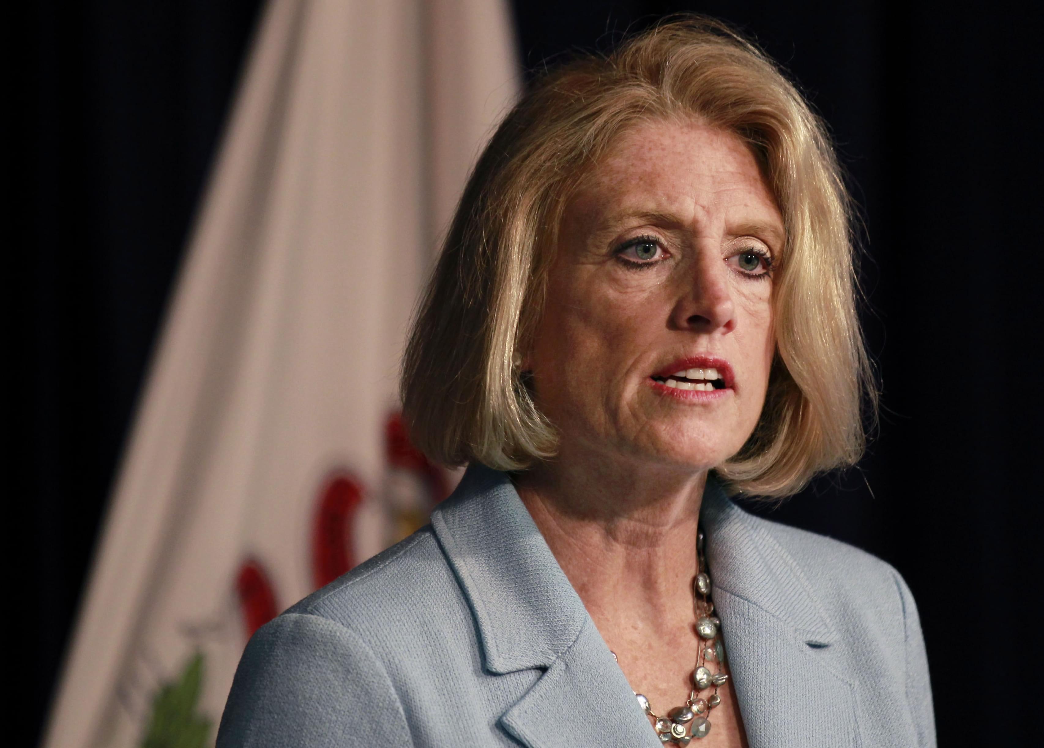 In this June 10, 2015 file photo, Illinois state Comptroller Leslie Munger speaks at a news conference in Chicago