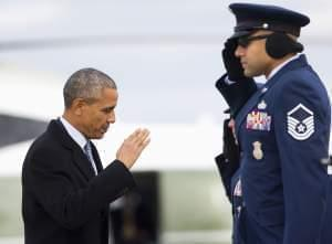 President Barack Obama returns a salute as he boards Air Force One before his departure from Andrews Air Force Base, Md.,Wednesday.  He's headed to Springfield.