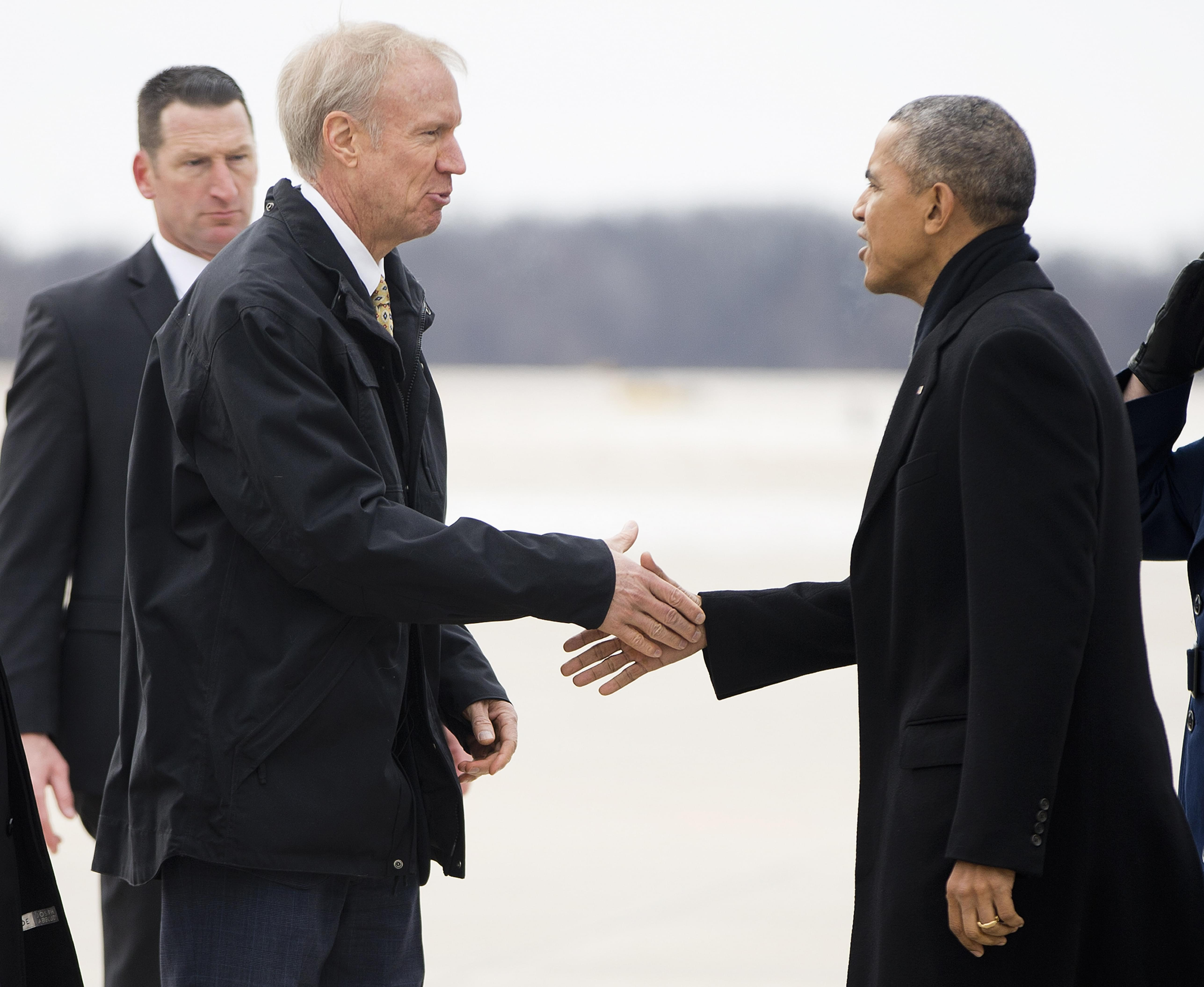 President Barack Obama is greeted by Illinois Gov. Bruce Rauner on the tarmac during his arrival on Air Force One at Abraham Lincoln Capitol Airport in Springfield Wednesday.