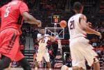 Illini freshman guard Aaron Jordan passes to Malcolm Hill Tuesday night against Rutgers.