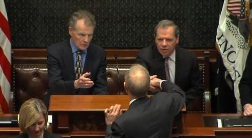 Gov. Bruce Rauner shakes hands with the General Assembly's Democratic leaders, House Speaker Michael Madigan and Senate President John Cullerton.