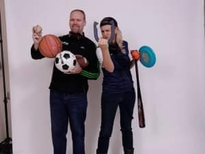 Brian Moline and Lisa Bralts holding all sorts of sports equipment