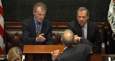 Gov. Bruce Rauner shakes hands with General Assembly Democratic leaders Michael Madigan and John Cullerton.