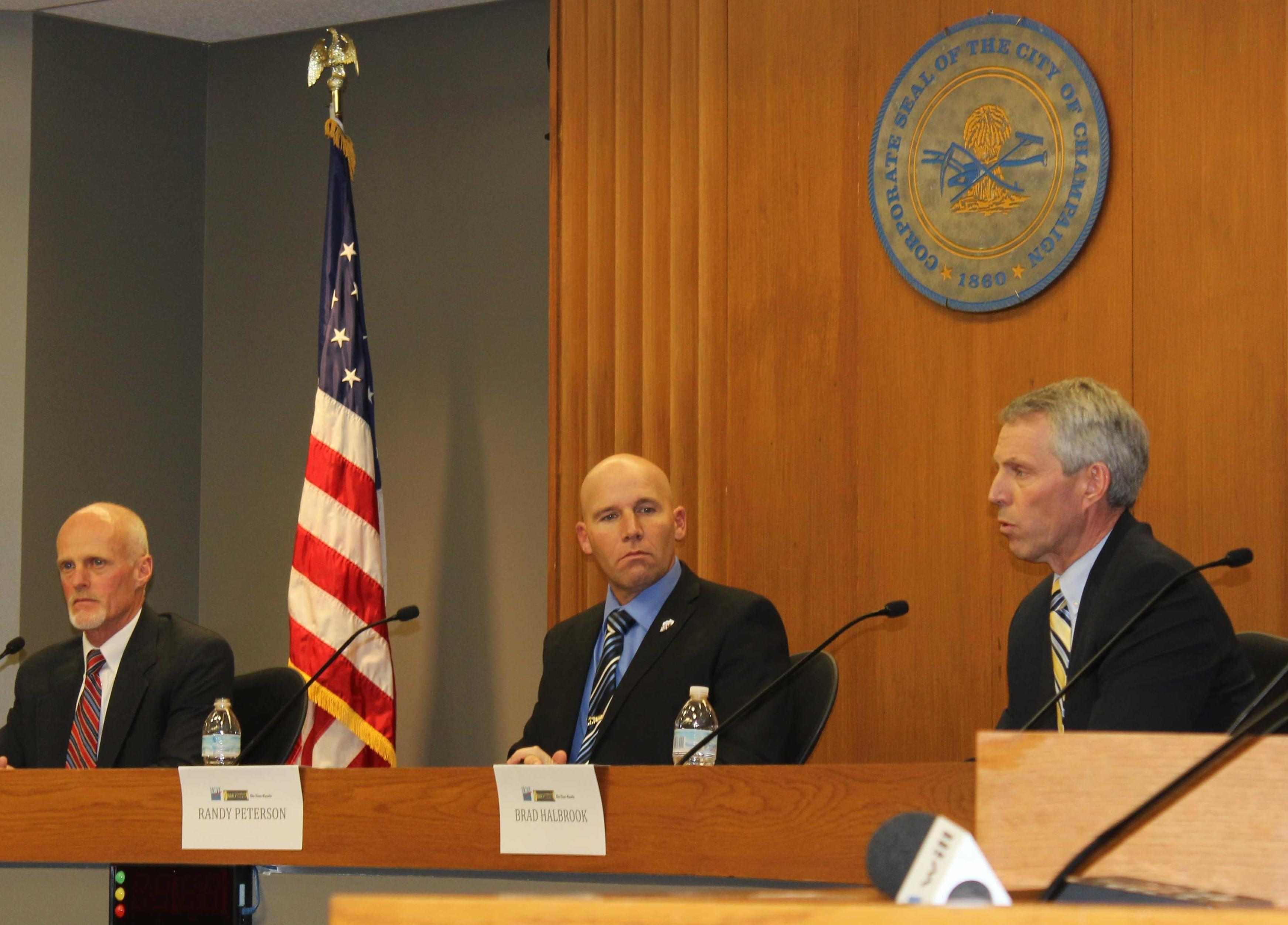 Randy Peterson (middle) debates fellow candidates Jim Acklin (left) and Brad Halbrook for Illinois' 102nd District House race at the Champaign City Building February 17.