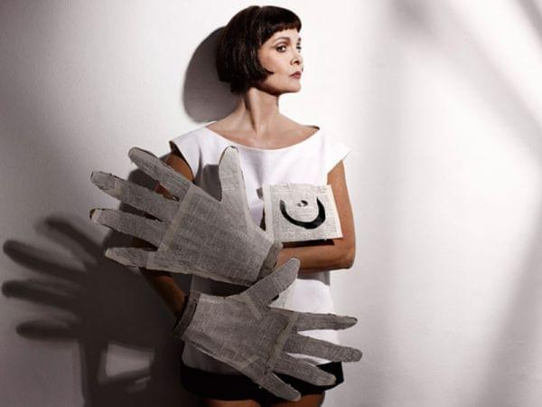 Woman with large paper gloves on