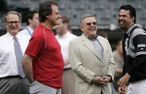 Chicago White Sox chairman Jerry Reinsdorf, left, manager Ozzie Guillen, right, vice chairman Eddie Einhorn, center right, and former St. Louis Cardinals manager Tony La Russa talk before a baseball game between the two clubs in Chicago, Tuesday, Jun
