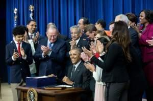 President Barack Obama signs the Every Student Succeed Act in December 2015