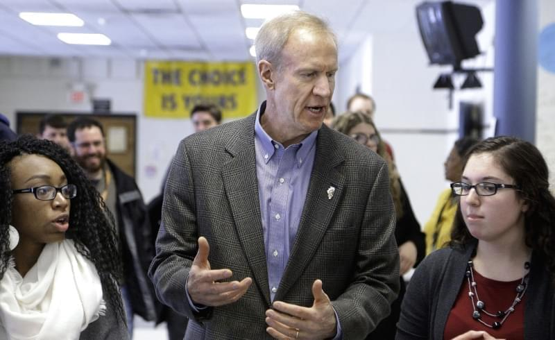 n this Feb. 24, 2016 photo, Illinois Gov. Bruce Rauner visits with students hoping to attend college during a visit to Southeast High School in Springfield, where he discussed his education agenda.