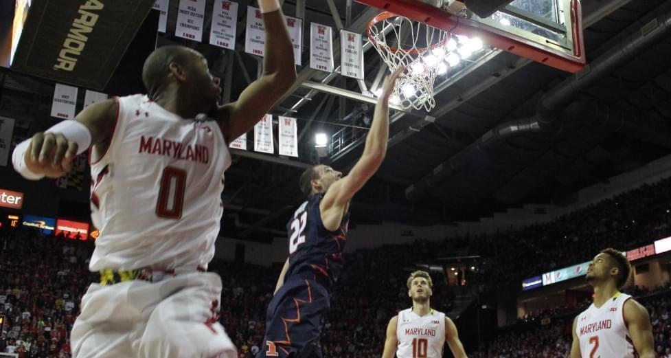 Illini basketball player Maverick Morgan making a layup.