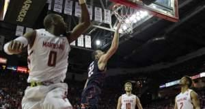 Illini basketball player Maverick Morgan making a layup.