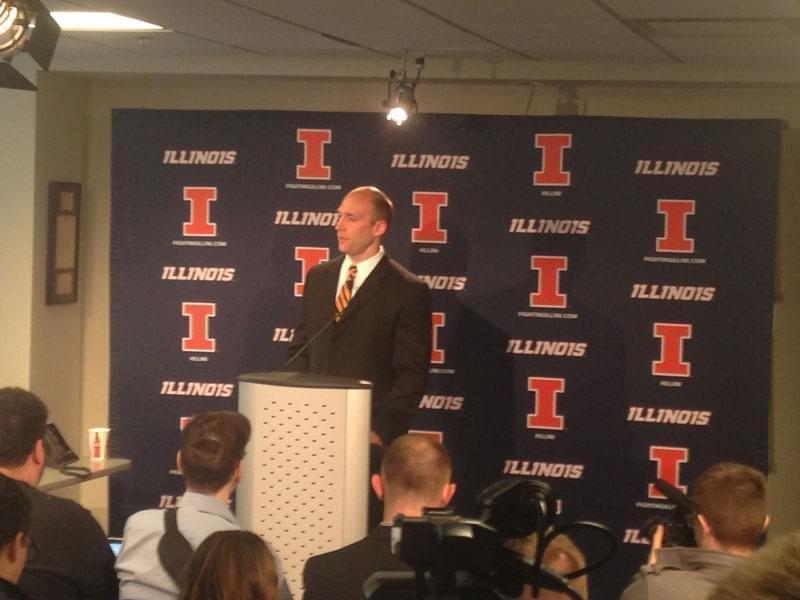 Illinois athletic director Josh Whitman answering questions in a news conference.