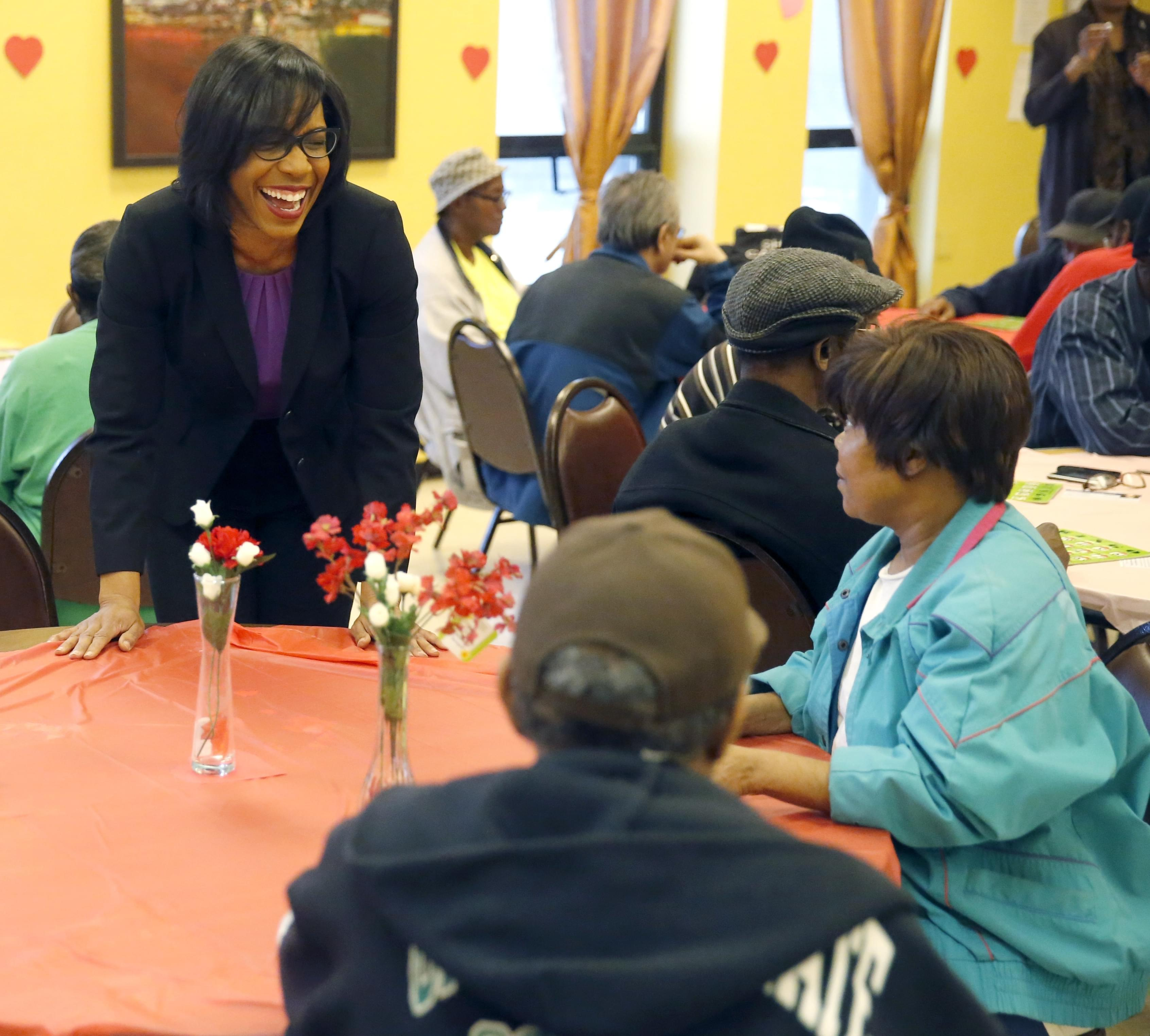 In this Feb. 12, 2016 photo, Democrat Juliana Stratton talks to residents during a bingo party at the Minnie Ripperton apartments in Chicago.Stratton, is trying to unseat incumbent Democratic state Rep. Ken Dunkin. ""