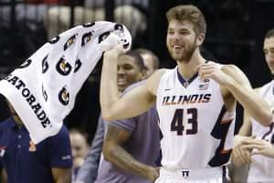 Illinois' Michael Finke (43) reacts on the bench in the second half of an NCAA college basketball game against Minnesota at the Big Ten Conference tournament, Wednesday, March 9, 2016, in Indianapolis. Illinois won 85-52.