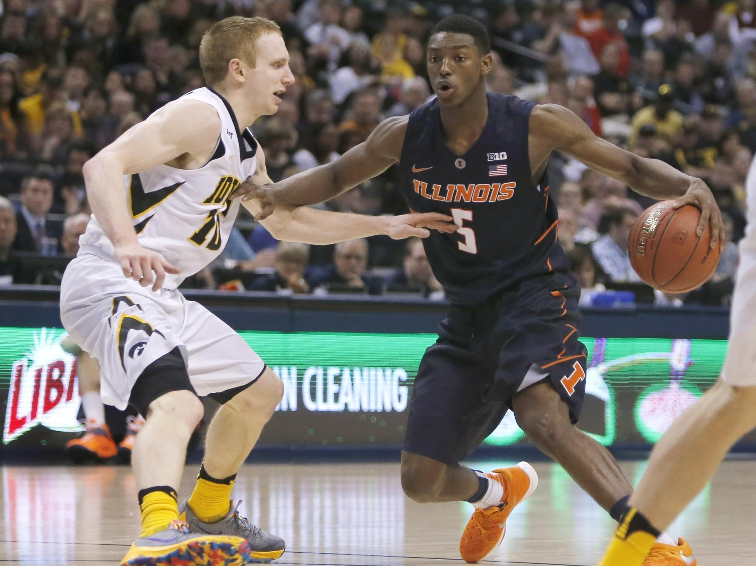 Illinois' Jalen Coleman-Lands (5) drives against Iowa's Mike Gesell (10) in the second half of an NCAA college basketball game at the Big Ten Conference tournament Thursday.