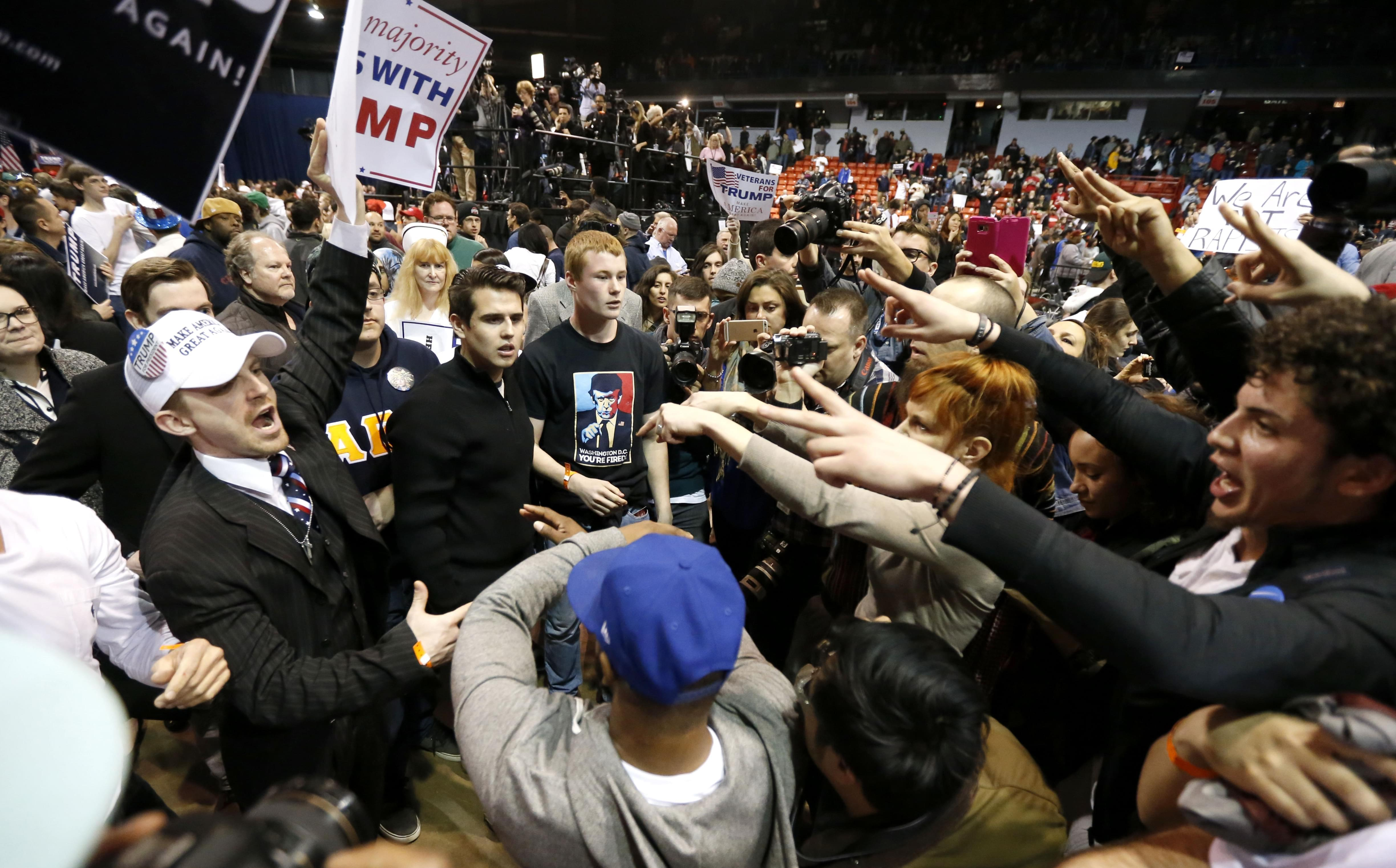 upporters of Republican presidential candidate Donald Trump, left, face off with protesters after a rally on the campus of the University of Illinois-Chicago was cancelled due to security concerns Friday,