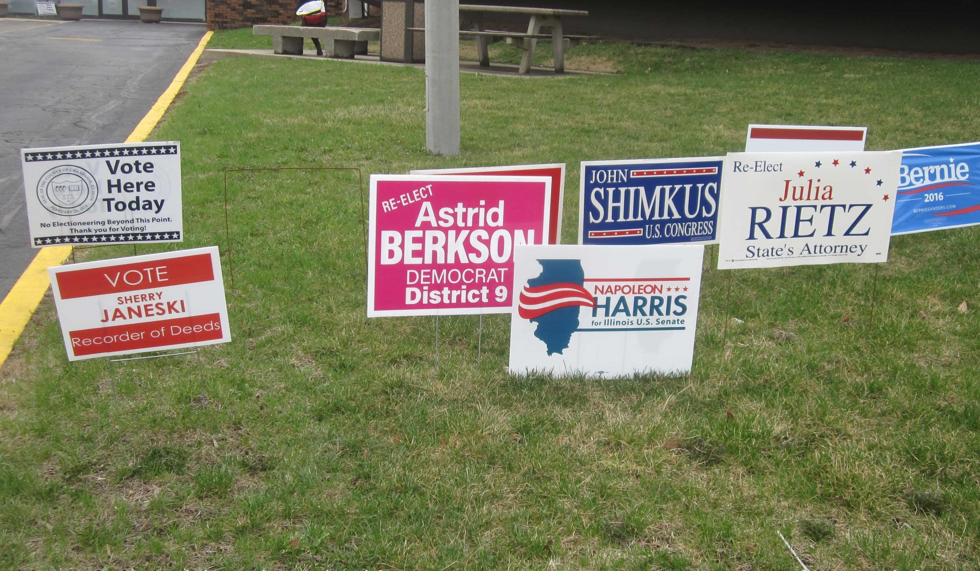 Campaign signs in front of the Brookens Administrative Center