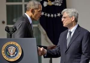 Federal appeals court judge Merrick Garland, right, shakes hands with President Barack Obama as he is introduced as Obama's nominee for the Supreme Court during an announcement in the Rose Garden of the White House, in Washington, Wednesday, Mar