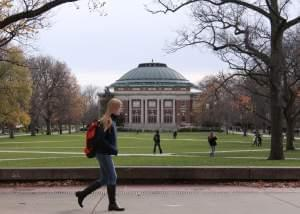In this Nov. 20, 2015 file photo, University of Illinois students walk across the Main Quad on campus in Urbana.