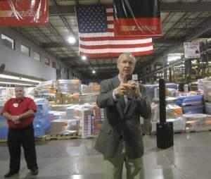 Gov. Bruce Rauner at an AutoZone distribution facility in Danville