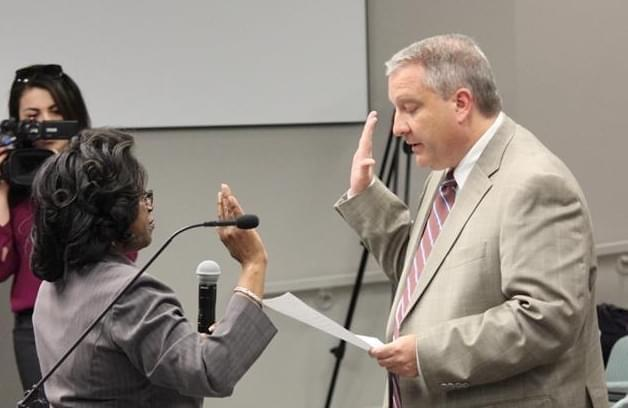 Greg Stock being sworn in as a member of the Champaign City Council.