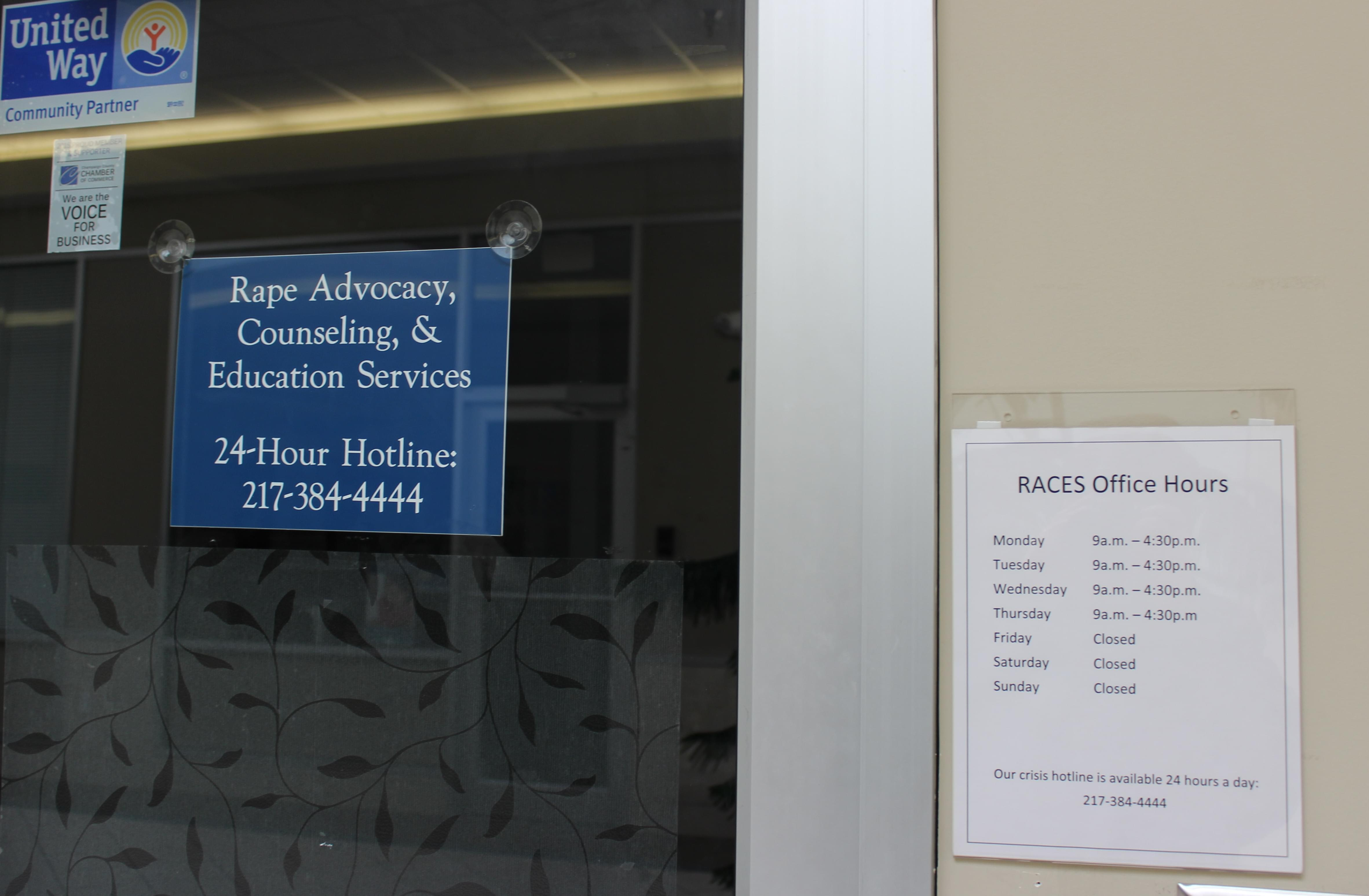 Signs on the door for the RACES agency in Urbana.