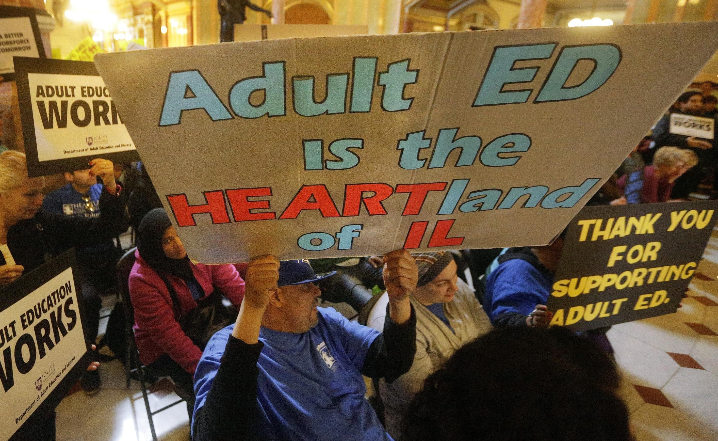 Supporters of education funding rally in the rotunda at the Illinois State Capitol Tuesday, April 12, 2016, in Springfield, Il. Illinois Gov. Bruce Rauner has released figures breaking down how much each Illinois school district would receive next ye