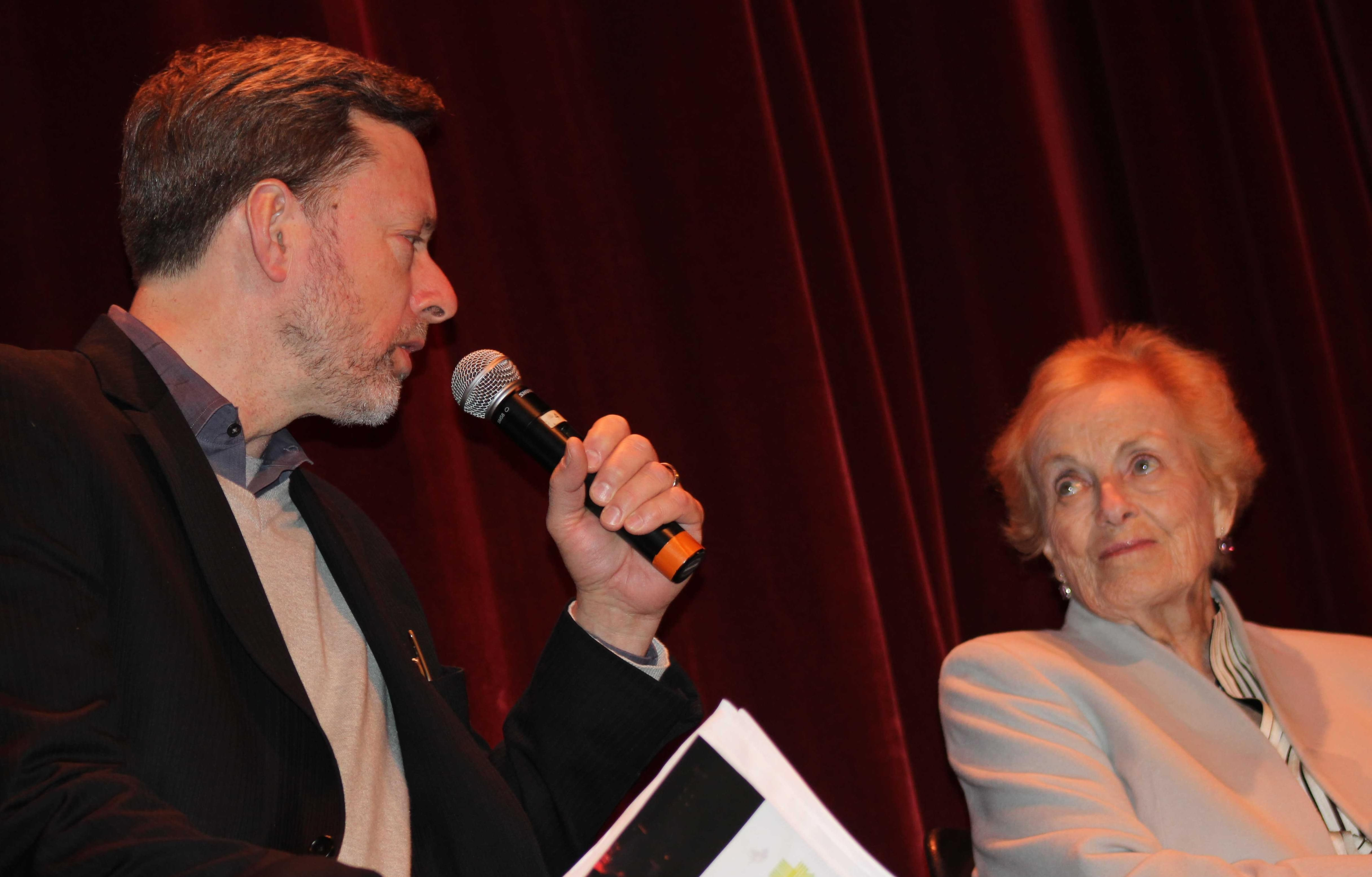 """Chicago Tribune Film Critic Michael Philllips talks with film crew veteran Angela Allen about the making of """"The Third Man,"""" at Champaign's Virginia Theater Thursday."""