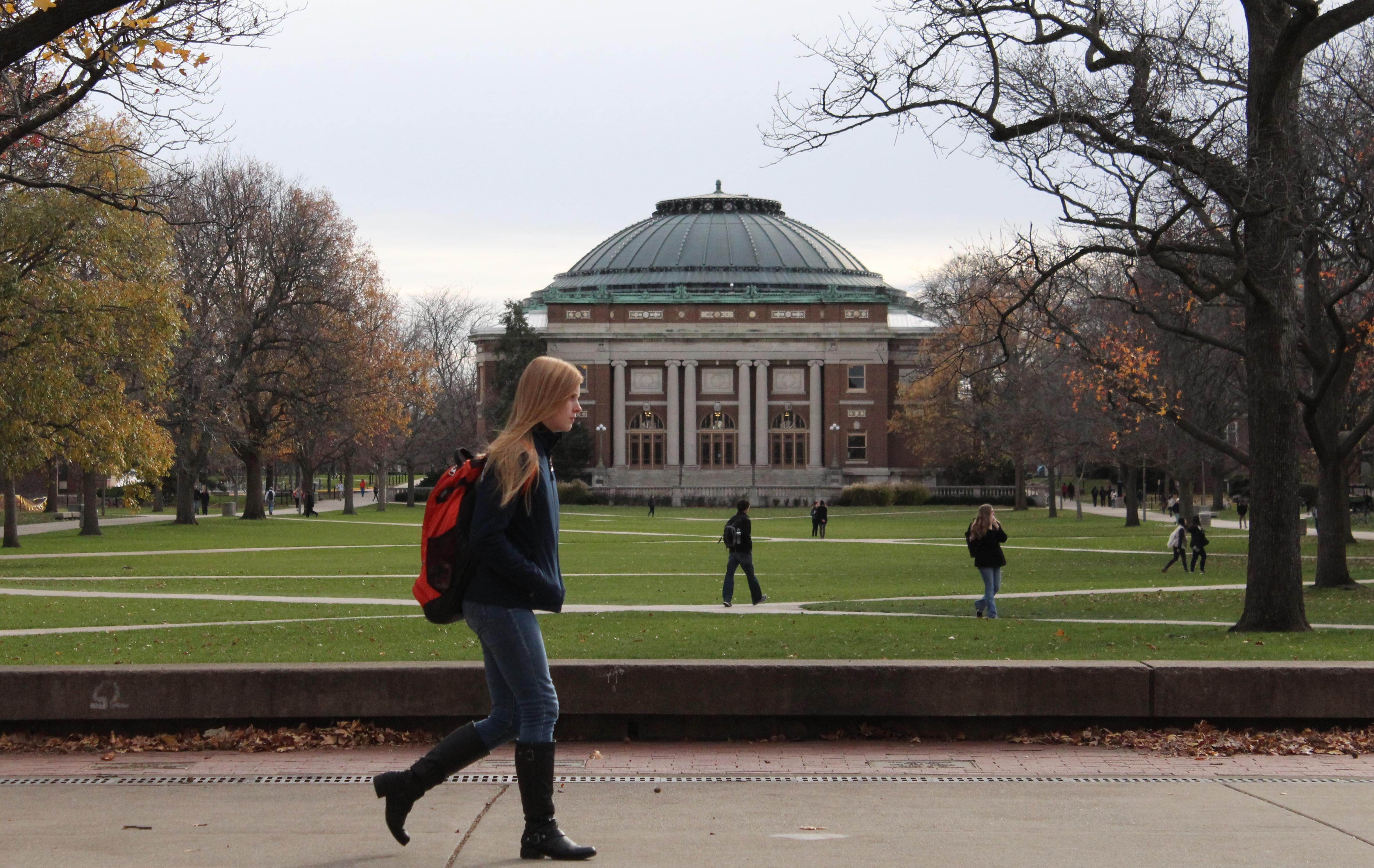 In this Nov. 20, 2015 photo, University of Illinois students walk across the Main Quad on campus in Urbana.
