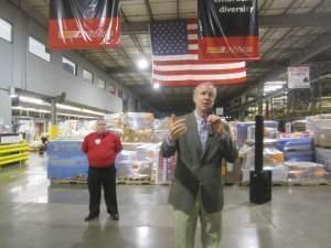 Gov. Bruce Rauner in a visit to an AutoZone distribution facility in Danville March 29.
