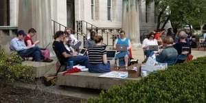 Members of the Non-Tenure Faculty Coalition hold a 'work-in' outside the Henry Administration Building.