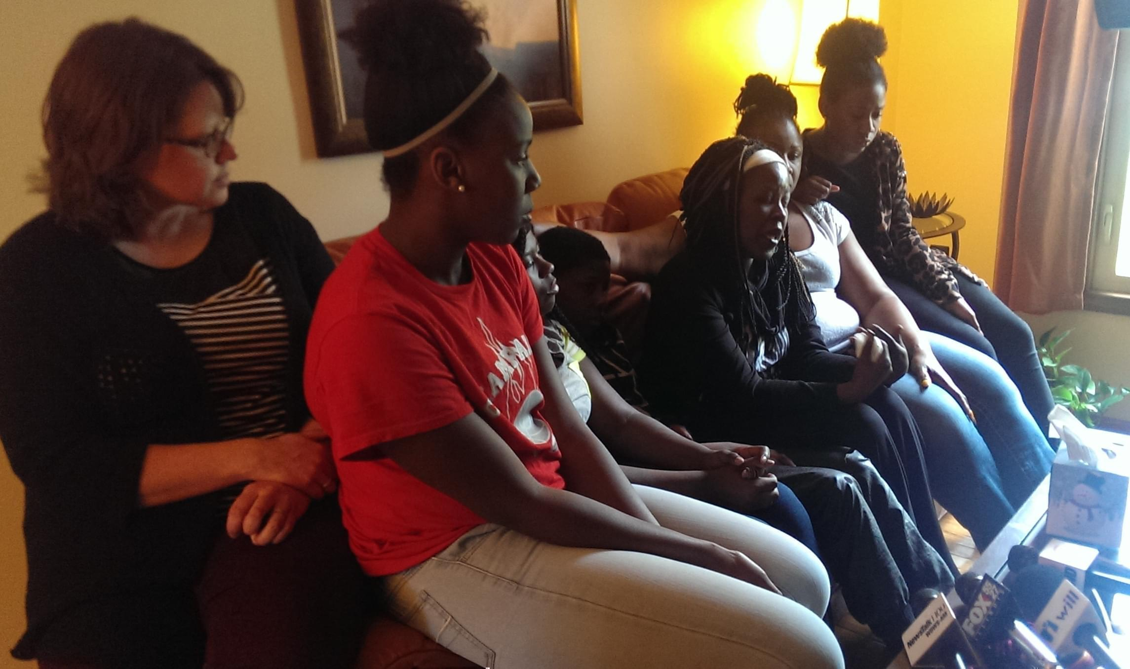 Family and friends of Ashley Gibson, who died last week, address the media in Champaign Wednesday.