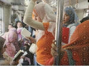 Muslim women ride the subway