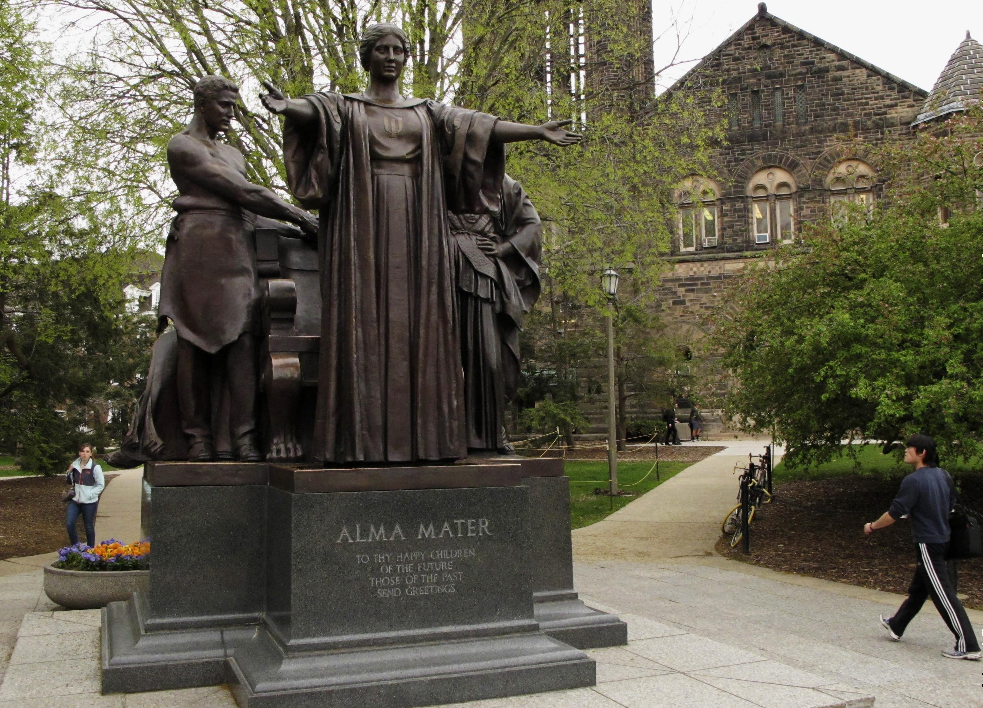 In this April 28, 2014 photo, students walk past the Alma Mater statue, a landmark on the University of Illinois campus in Urbana