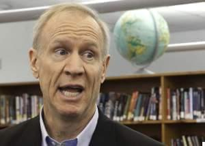 In this Wednesday, May 11, 2016 photo, Illinois Gov. Bruce Rauner visits with students at New Berlin High School in New Berlin, Ill. Rauner's vision of a grand, two-year budget compromise with Illinois lawmakers is becoming more difficult to acc