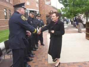 Illinois Supreme Court Chief Justice Rita Garman greets Parkland College Police Chief William Colbrook.